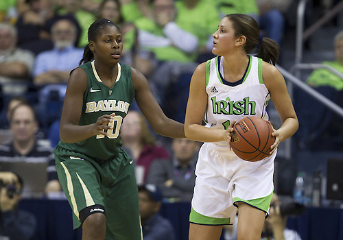 December 05, 2012:  Notre Dame forward Natalie Achonwa (11) looks to pass the ball as Baylor forward Destiny Williams (10) defends during NCAA Women's Basketball game action between the Notre Dame Fighting Irish and the Baylor Bears at Purcell Pavilion at the Joyce Center in South Bend, Indiana.  Baylor defeated Notre Dame 73-61.