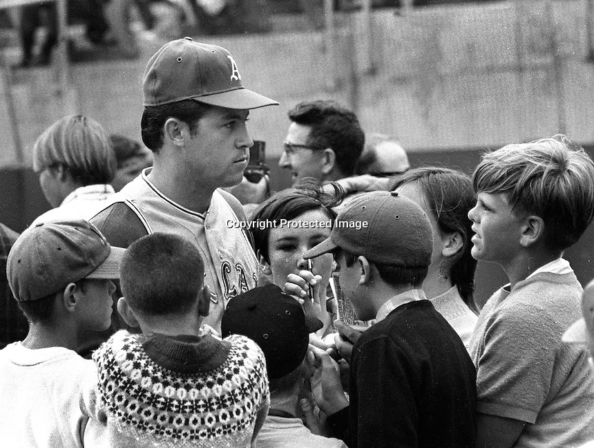 "Oakland Athletics pitcher Jim ""Catfish"" Hunter with a group of young fans. (1969 photo/Ron Riesterer)"