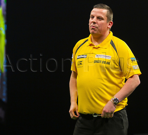 31.03.2016. The Motorpoint Arena, Cardiff.  Betway PDC Premier League Darts Judgement Night. Dave Chisnall shows his frustration after a dart bounce's out of the board