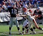 Oakland Raiders vs. Cincinnati Bengals at Oakland Alameda County Coliseum Sunday, October 25, 1998.  Raiders beat Bengals 27-10.  Cincinnati Bengals defensive end Clyde Simmons (96) rushes Oakland Raiders quarterback Donald Hollas (12).