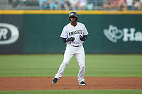 Luis Robert (9) of the Charlotte Knights takes his lead off of second base against the Gwinnett Braves at BB&T BallPark on July 12, 2019 in Charlotte, North Carolina. The Stripers defeated the Knights 9-3. (Brian Westerholt/Four Seam Images)