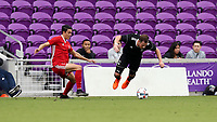 Orlando, Florida - Saturday January 13, 2018: Tim Kubel is tripped by Justin Fiddes. Match Day 1 of the 2018 adidas MLS Player Combine was held Orlando City Stadium.