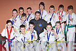 Jason Moriarty with his Tae Kwon Do students from Killarney that won medals at the Munster Championships held in tralee Sporting complex last weekend feront row l-r: Katie Lynch, Benjamin Guaghrin, Cian O'Connor, Tommy O'Regan, Cliona Lynch. Back row: Mark Fitzgerald, Ewan MacIndoe, Alex Regan, Maura O'Reilly, Luke Regan, Trevor Cremin and Cian O'Sullivan