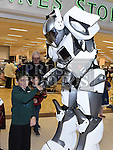 Jake tenanty met a robot at the Halloween celebrations at the Drogheda Town Centre. Photo:Colin Bell/pressphotos.ie