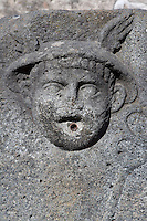 Fountain of Mercury, Via di Mercurio, Pompeii, showing the God's Head with his winged cap. One of 42 public fountains fed by lead piping from water towers around the city