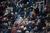 Lincoln City fans watch their team in action<br /> <br /> Photographer Chris Vaughan/CameraSport<br /> <br /> The EFL Checkatrade Trophy Northern Group H - Lincoln City v Wolverhampton Wanderers U21 - Tuesday 6th November 2018 - Sincil Bank - Lincoln<br />  <br /> World Copyright © 2018 CameraSport. All rights reserved. 43 Linden Ave. Countesthorpe. Leicester. England. LE8 5PG - Tel: +44 (0) 116 277 4147 - admin@camerasport.com - www.camerasport.com