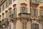 Windows and balconies of a building in Turin, Italy
