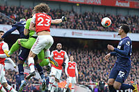 Bernd Leno of Arsenal FC punches a cross but takes out David Luiz of Arsenal FC during Arsenal vs West Ham United, Premier League Football at the Emirates Stadium on 7th March 2020