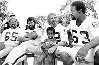 Oakland Raiders relax at Family Day , Mickey Marvin, John Vella, Ken Stabler and Gene Upshaw with unidentified fan...(1979 photo/RonRiesterer)