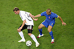 04 July 2006: Fabio Cannavaro (ITA) (5) looks for an opportunity to take the ball off the feet of Lukas Podolski (GER) (20). Italy defeated Germany 2-0 in overtime at Signal Iduna Park, better known as Westfalenstadion, in Dortmund, Germany in match 61, the first semifinal game, in the 2006 FIFA World Cup.