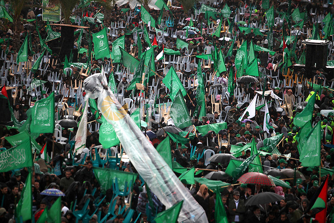 Palestinian Hamas supporters attend a Hamas rally marking the 25th anniversary of the Islamist movement's founding  in Gaza City on December 8, 2012. Hamas chief Khaled Meshaal arrived to Gaza strip on December 7 during his first-ever visit to the Gaza Strip amid tight security for festivities marking the ruling Islamist movement's 25th. Photo by Majdi Fathi