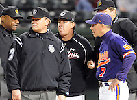 Head coach Ray Tanner (1) of South Carolina meets with the umpires and head coach Jack Leggett (7) of the Clemson Tigers before a game against the Clemson Tigers on Tuesday, March 8, 2011, at Fluor Field in Greenville, S.C. USC won 5-4.  Photo by Tom Priddy / Four Seam Images