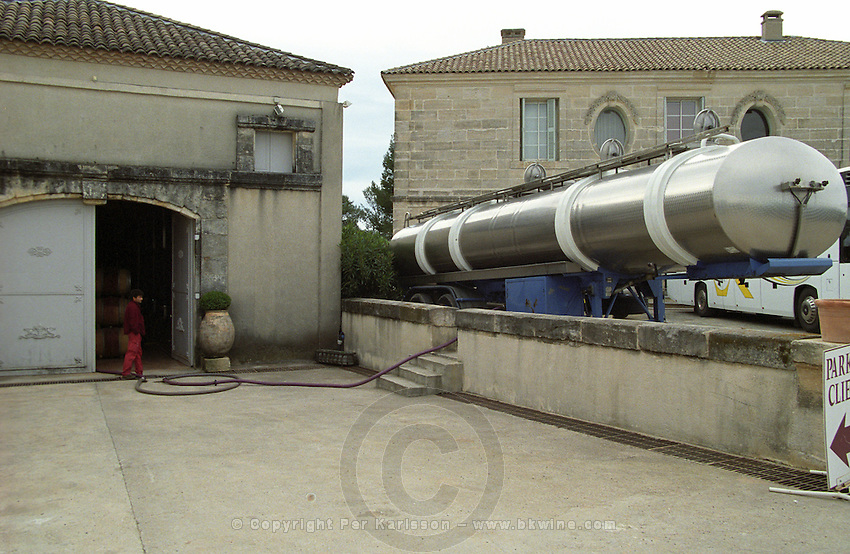 Chateau Peuch-Haut, St Drezery. Gres de Montpellier. Languedoc. The winery building. Delivering wine with a tanker truck. Pumping wine. France. Europe.