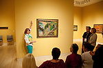 USA, Indiana, Indianapolis, docent leading tour of paintings at Indiana Museum of Art.