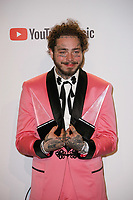 LOS ANGELES, CA - OCTOBER 09: Post Malone, winner of the Favorite Male Artist - Pop/Rock award, poses in the press room during the 2018 American Music Awards at Microsoft Theater on October 9, 2018 in Los Angeles, California. <br /> CAP/MPI/IS<br /> &copy;IS/MPI/Capital Pictures