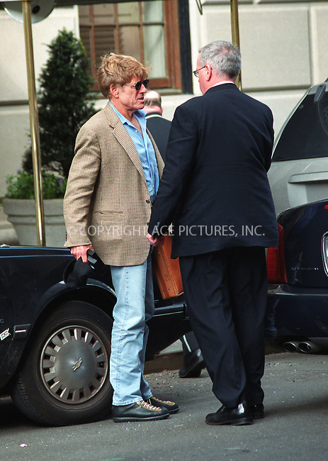 *EXCLUSIVE*   ..Actor Robert Redford making arrangements with his driver outside Robert's house in New York. April 24, 2002. Please byline: Alecsey Boldeskul/NY Photo Press.   ..*PAY-PER-USE*      ....NY Photo Press:  ..phone (646) 267-6913;   ..e-mail: info@nyphotopress.com
