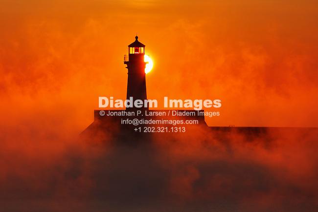 Winter sunrise behind lighthouse in Duluth, Minnesota.