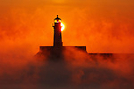 Winter sunrise behind lighthouse in Duluth, Minnesota.