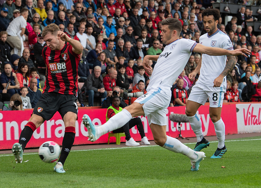 Bournemouth's Jack Stacey (left) crosses the ball despite the attentions of  West Ham United's Aaron Cresswell (right) <br /> <br /> Photographer David Horton/CameraSport<br /> <br /> The Premier League - Bournemouth v West Ham United - Saturday 28th September 2019 - Vitality Stadium - Bournemouth<br /> <br /> World Copyright © 2019 CameraSport. All rights reserved. 43 Linden Ave. Countesthorpe. Leicester. England. LE8 5PG - Tel: +44 (0) 116 277 4147 - admin@camerasport.com - www.camerasport.com