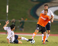 Tamir Cohen of the Bolton Wanderers slides for the ball against the Charlotte Eagles Ben Page.  The Charlotte Eagles currently in 3rd place in the USL second division played a friendly against the Bolton Wanderers from the English Premier League losing 3-0.