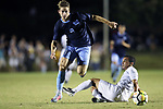 CARY, NC - OCTOBER 06: UNC's Jack Skahan (8) and Wake Forest's Eddie Folds (19). The University of North Carolina Tar Heels hosted the Wake Forest University Demon Deacons on October 6, 2017 at Koka Booth Field at WakeMed Soccer Park in Cary, NC in a Division I college soccer game.