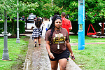 Britney Christian walks from a parking lot to one of the dorm buildings at Harris-Stowe State University in St. Louis on Wednesday August 15, 2018.    Photo by Tim Vizer