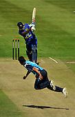 Cricket - ODI Summer Tri-Series - Scotland V Sri Lanka at Grange CC - Edinburgh - Scotland bowler Safyaan Sharif still in mid air as Sri Lanka bat Angelo Matthews sends the ball to long on - Picture by Donald MacLeod - 13.07.11 - 07702 319 738 - www.donald-macleod.com