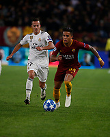Lucas Vazquez of Real Madrid  and Justin Kluivert of AS Roma  during the Champions League Group  soccer match between AS Roma - Real Madrid  at the Stadio Olimpico in Rome Italy 27 November 2018