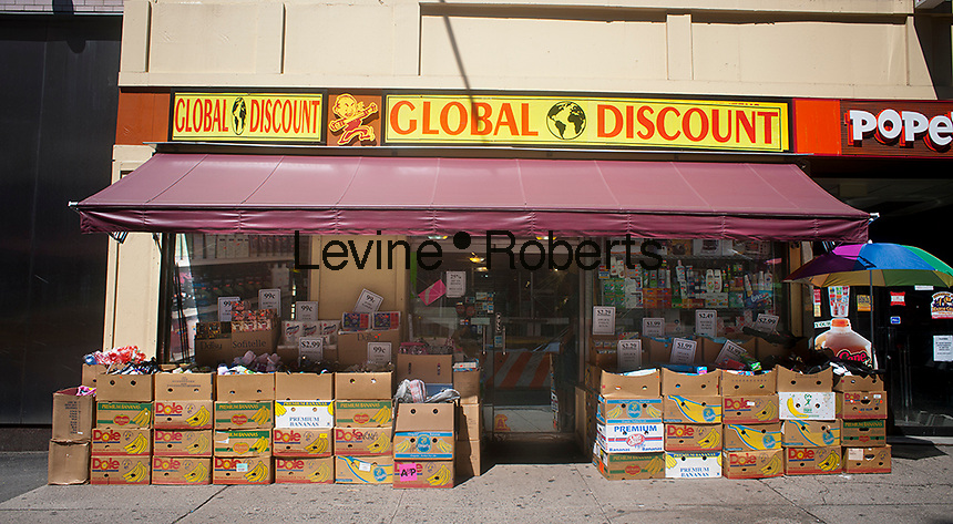 A discount store displays its merchandise on the sidewalk in front of the store in Lower Manhattan in New York,  seen on Sunday, July 22, 2012. (© Richard B. Levine)