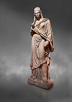Roman statue of Plancia Magna a prominent woman from Anatolia who lived between the 1st century and 2nd century in the Roman Empire. Marble . Perge. 2nd century AD. Inv no 3459 . Antalya Archaeology Museum; Turkey. Against a grey background