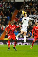 Real Madrid´s Isco and Sevilla's Stephane Mbia during 2014-15 La Liga match between Real Madrid and Sevilla at Santiago Bernabeu stadium in Alcorcon, Madrid, Spain. February 04, 2015. (ALTERPHOTOS/Luis Fernandez) /NORTEphoto.com
