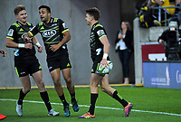 Jordie Barrett (left) and Chase Tiatia celebrate Beauden Barrett's (right) try during the Super Rugby match between the Hurricanes and Rebels at Westpac Stadium in Wellington, New Zealand on Saturday, 4 May 2019. Photo: Dave Lintott / lintottphoto.co.nz