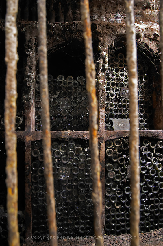 old bottles in the cellar domaine doudet naudin savigny-les-beaune cote de beaune burgundy france