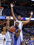 Kentucky Wildcats forward Bam Adebayo is defended by North Carolina Tar Heels guard Joel Berry II and forward Kennedy Meeks during the 2017 NCAA Men's Basketball Tournament South Regional Elite 8 at FedExForum in Memphis, TN on Friday March 24, 2017. Photo by Michael Reaves | Staff