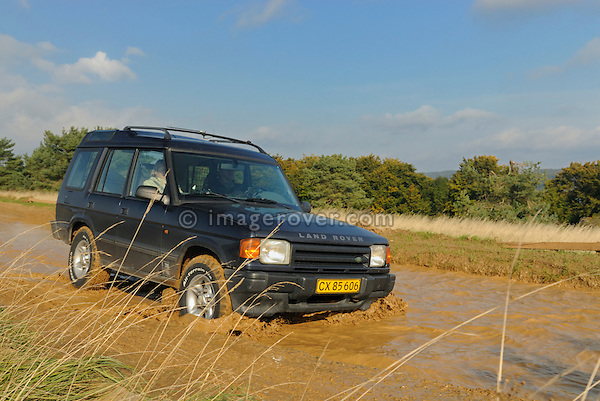 1990s Land Rover Discovery 1 crossing a flooded forest track. Seen at an off-road event of the German Land Rover Club held at the Freizeitpark Mammut in Stadtoldendorf, Germany, October 3.-5. 2008. --- No releases available. Automotive trademarks are the property of the trademark holder, authorization may be needed for some uses.