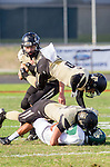 Palos Verdes, CA 10/25/13 - P.J. Onusconich (Mira Costa #4) and AJ Hezlep (Peninsula #12) in action during the Mira Costa vs Peninsula varsity football game at Palos Verdes Peninsula High School.