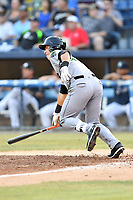 Augusta GreenJackets second baseman Orlando Garcia (23) swings at a pitch during a game against the Asheville Tourists at McCormick Field on June 15, 2018 in Asheville, North Carolina. The Tourists defeated the GreenJackets 6-5. (Tony Farlow/Four Seam Images)