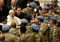 Papa Francesco saluta soldati argentini delle Nazioni Unite al termine dell'Udienza Generale del mercoledi' in aula Paolo VI, Citta' del Vaticano, 14 dicembre 2016.<br /> Pope Francis greets Argentinian soldiers of the United Nations at the end of his weekly general audience in Paul VI Hall at the Vatican, on December 14, 2016.<br /> UPDATE IMAGES PRESS/Isabella Bonotto<br /> <br /> STRICTLY ONLY FOR EDITORIAL USE