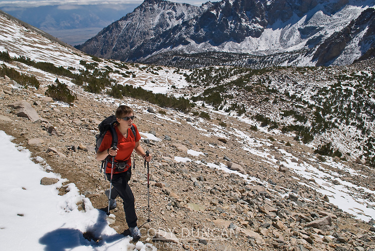 Female hiker on Kearsarge Pass tail in the Sierra Nevada Mountains, California