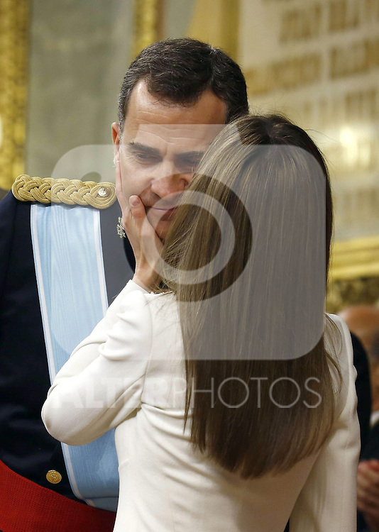 Princess Letizia of Spain kissing his husband Prince Felipe VI of Spain at the official ceremony to become chief commander of the spanish military forces. . June 19 ,2014. (ALTERPHOTOS/EFE/Pool)