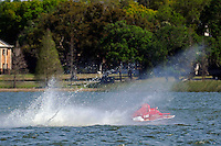 "Y-563 ""Lobster Boat"" takes a bad hop racing into turn one.  (1 Litre MOD hydroplane(s)"
