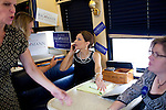 Republican presidential hopeful Michele Bachmann talks on the phone with Speaker of the House John Boehner (R-OH) after a campaign stop on Sunday, July 24, 2011 in Muscatine, IA.