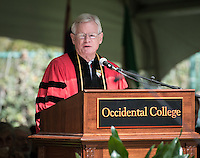 "Professor A.H. ""Woody"" Studenmund accepts a posthumous honorary degree for his son, U.S. Army Special Forces Staff Sgt. Scott Studenmund, at Occidental College's 133rd Commencement at the Remsen Bird Hillside Theater, on Sunday, May 17, 2015.<br />