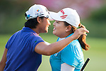 TAOYUAN, TAIWAN - OCTOBER 26:  Yani Tseng of Taiwan and Inbee Park of South Korea embraces on the 18th hole during the day two of the Sunrise LPGA Taiwan Championship at the Sunrise Golf Course on October 26, 2012 in Taoyuan, Taiwan. Photo by Victor Fraile / The Power of Sport Images