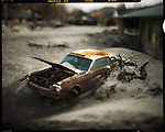 TRACES: KATRINA<br /> A lone Ford Mustang, near the 17th st canal, covered in sand after the levees broke.
