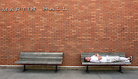 Joey Maxwell, a prospective Clemson University student from Atlanta, naps outside of Martin Hall on the university's campus Wednesday afternoon. Maxwell said he arrived at an admissions interview early and decided to prepare for it by resting for a while.