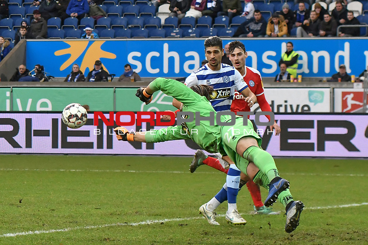 02.12.2018, Schauinsland-Reisen-Arena, Duisburg, GER, 2. FBL, MSV Duisburg vs. Holstein Kiel, DFL regulations prohibit any use of photographs as image sequences and/or quasi-video<br /> <br /> im Bild Daniel Mesenh&ouml;ler / Mesenhoeler (#27, MSV Duisburg) pariert den Ball<br /> <br /> Foto &copy; nordphoto/Mauelshagen