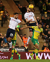 Bolton Wanderers' Mark Beevers wins the aerial battle with Norwich City's Jamal Lewis<br /> <br /> Photographer David Shipman/CameraSport<br /> <br /> The EFL Sky Bet Championship - Norwich City v Bolton Wanderers - Saturday 8th December 2018 - Carrow Road - Norwich<br /> <br /> World Copyright &copy; 2018 CameraSport. All rights reserved. 43 Linden Ave. Countesthorpe. Leicester. England. LE8 5PG - Tel: +44 (0) 116 277 4147 - admin@camerasport.com - www.camerasport.com