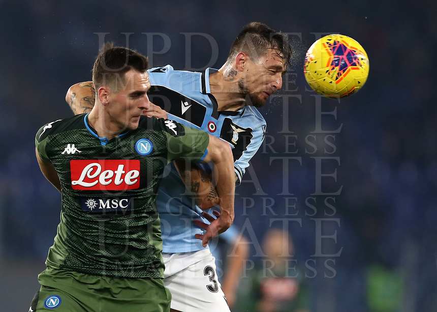 Football, Serie A: S.S. Lazio - Napoli, Olympic stadium, Rome, January 11, 2020.<br /> Lazio's Francesco Acerbi (r) in action with Napoli's Arkadiusz Milik (l) during the Italian Serie A football match between S.S. Lazio and Napoli at Rome's Olympic stadium, Rome , on January 11, 2020.<br /> UPDATE IMAGES PRESS/Isabella Bonotto