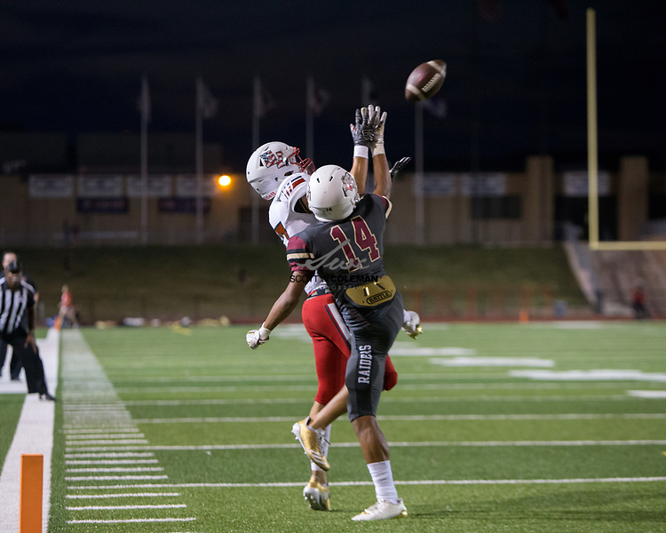 Rouse Raiders sophomore cornerback Isaiah Cash (14) defends a pass intended for an East View Patriots receiver during a high school football game between the Rouse Raiders and the East View Patriots at A.C. Bible Stadium in Leander, Texas, on Friday, September 15, 2017.